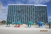 The unit comes with beach chairs and umbrellas