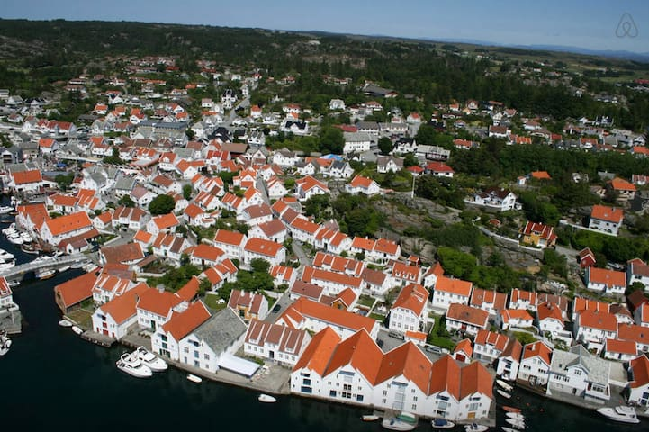 The old town of Skudeneshavn is a popular destination for tourists from all over the world. The old chapel is located in the center of the picture.