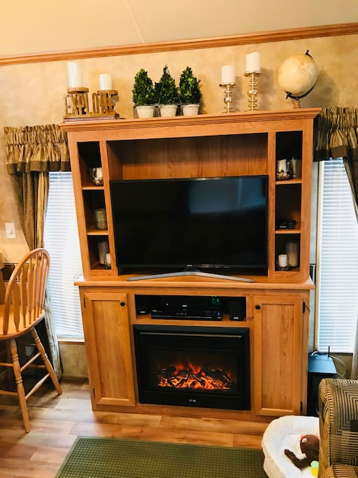 "An electric fireplace is a cozy cabin addition! The 40""  UHD TV comes with Hulu, Netflix, Spotify & HBO; there is also surround sound for music & movies; dog bed & ducky toy included :)"