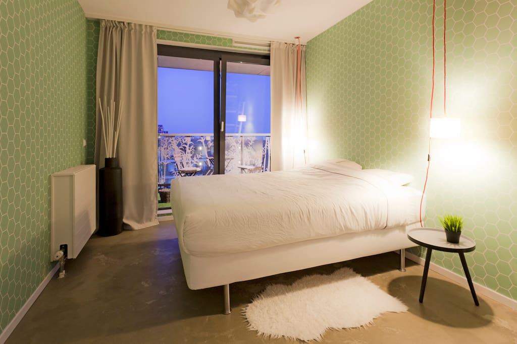 Calm bedroom with balcony