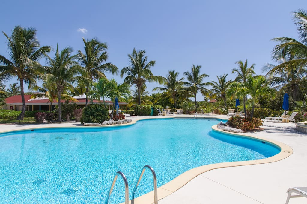 swim in the large oversize pool and hot tub with views of the ocean and sunsets and sunrises