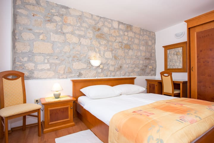 Spacious apartment with stone walls