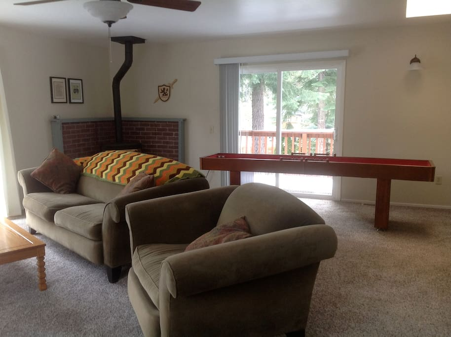 Family room with gas stove and shuffle puck game, 50 inch flat screen TV, extended cable and trundle beds sleeps 2.
