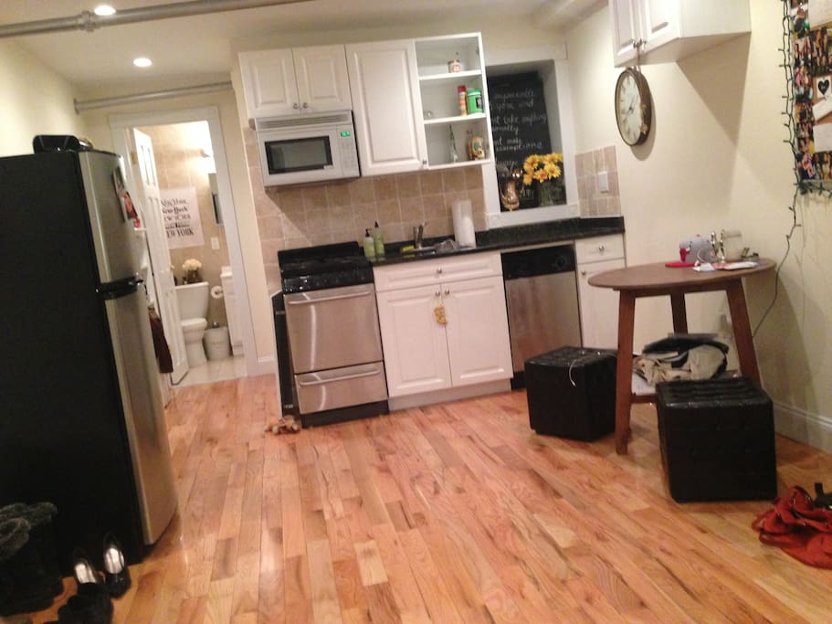 Spacious kitchen area with hallway to closet and bathroom.