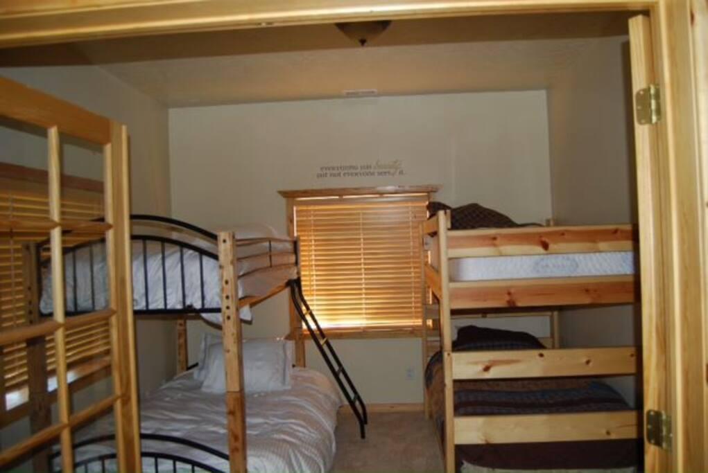 Basement bedroom adjacent to TV living room