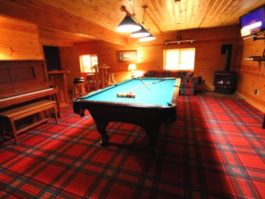 Game room with pool table, player piano