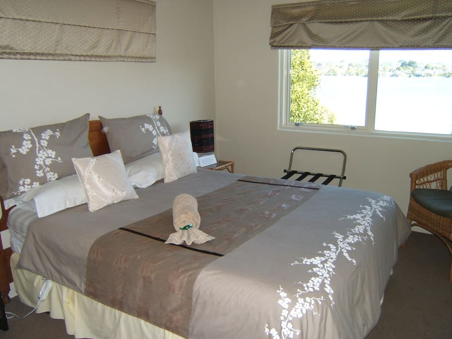 Your comfortable queen size bedroom with large picture window overlooking the sea.