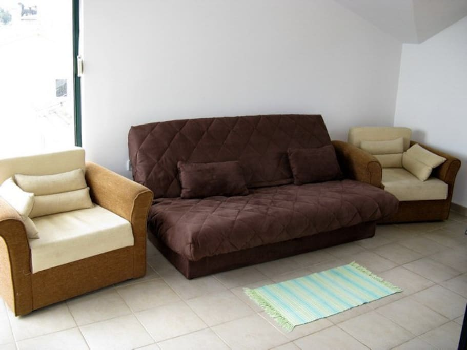 Sofa that can spread out into a comfortable bed. Also two armchairs can also spread out into bed each.
