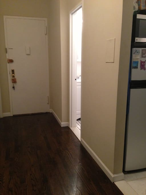 This is the entrance of the apt, bathroom is the first left (right in the picture) and then the kitchen.