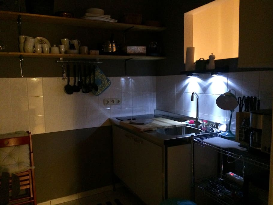 fully equipped single kitchen with kettle, coffee machine, grill, fridge, little freezer compartments, ceramic hob, toaster, pots, pans, glasses, etc