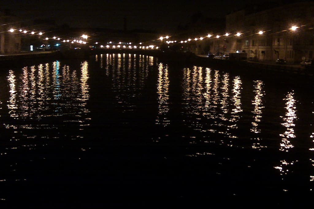 The Fontanka river from the Egyptian Bridge at night