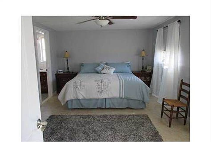 Master bedroom with private, newly remodeled bath. King sized bed.  Includes television in room.