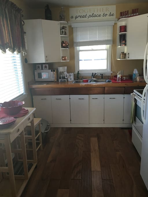 Newly remodeled functional kitchen with large window bringing in lots of sunshine.