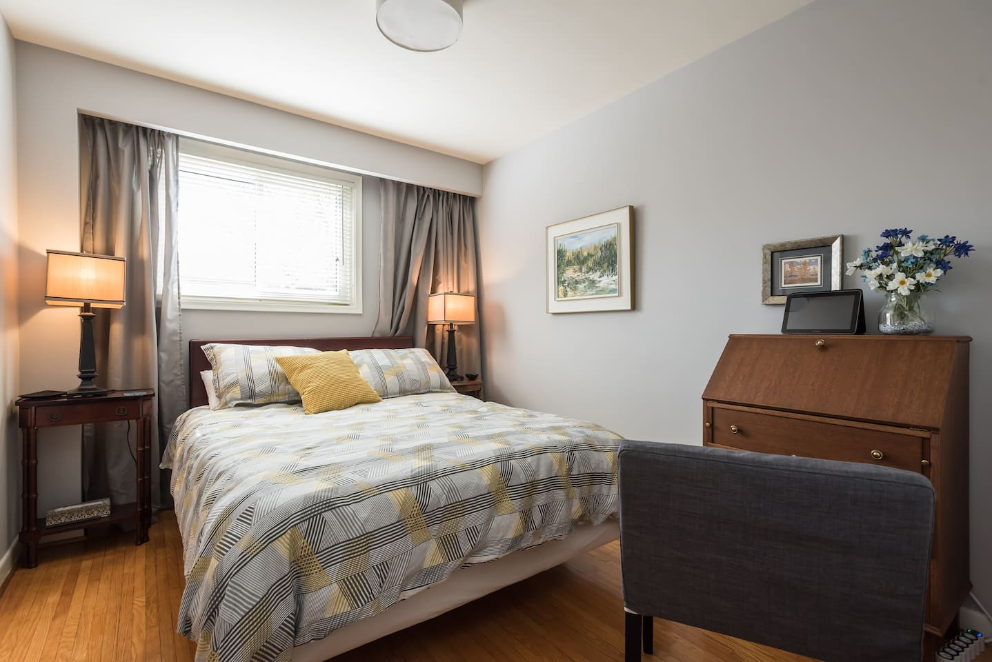 Private guest bedroom with queen-size bed, small desk, full use of closet and dresser and separate entrance.