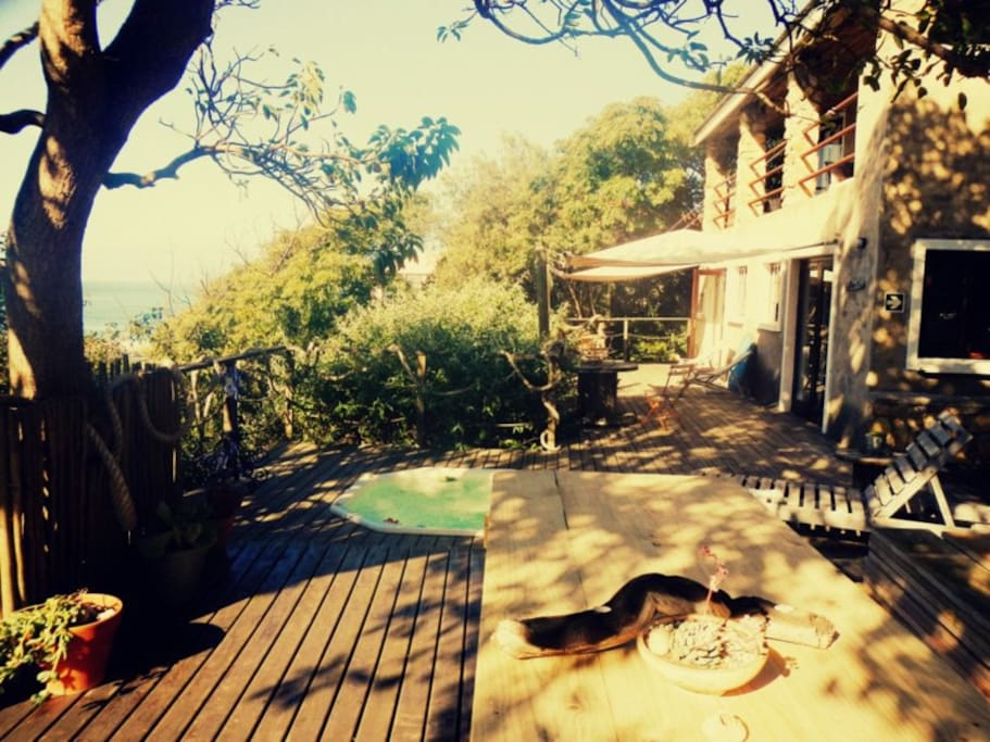 Walks out into the garden with the communal sun deck, and braai area overlooking Central Beach