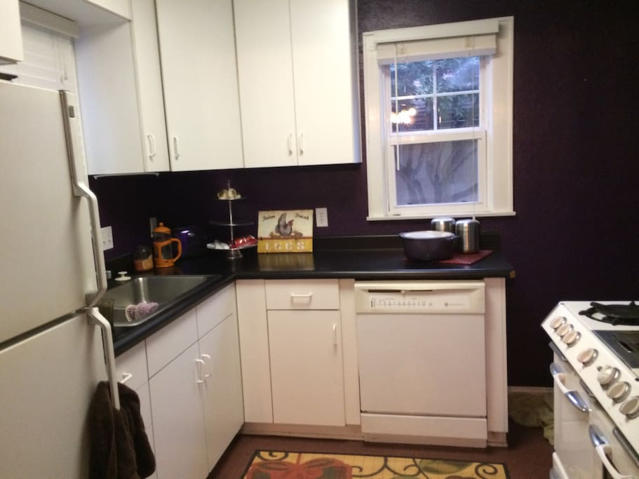 Kitchen has everything you need, including vintage gas oven and stovetop.