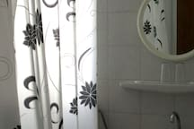 Bathroom with lots of light.  To see videos of the rooms, please try you tube hotel parko channel.