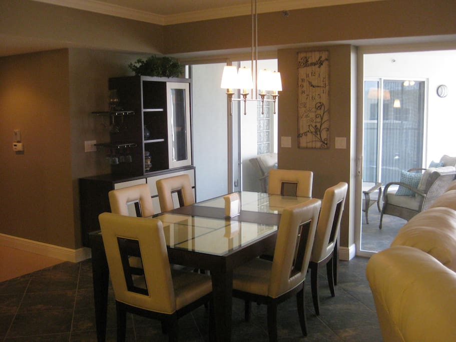 Dining room with leather chair set with access to the screened lanai