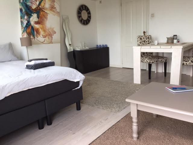 Bright private room with balcony and own bathroom