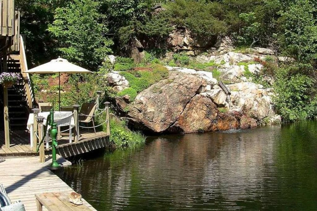 Cottage Home alongside Quarry Pond with waterfall.