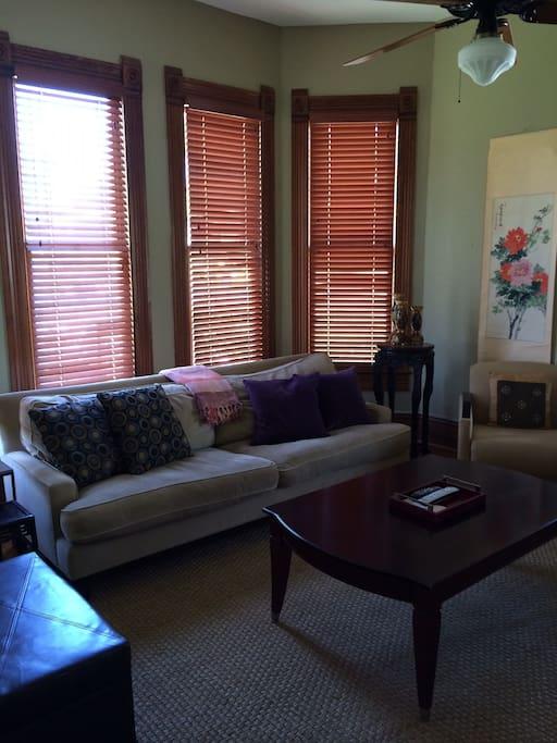 Living room- hardwood floors & 14ft ceilings