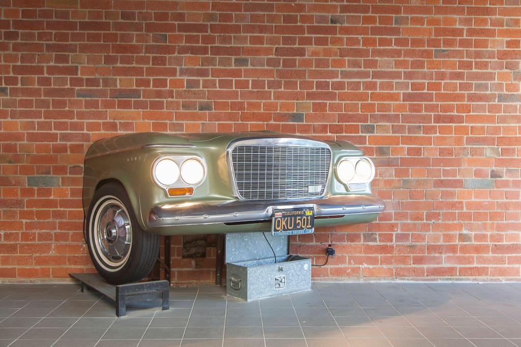 The original Studebaker Car in the Foyer of our Funky Apartment - lights up at night for your security on entrance.