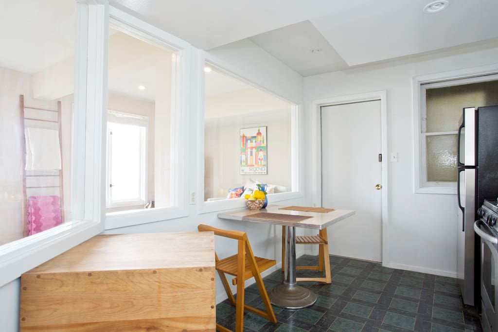 Kitchen with dining table and chopping block.