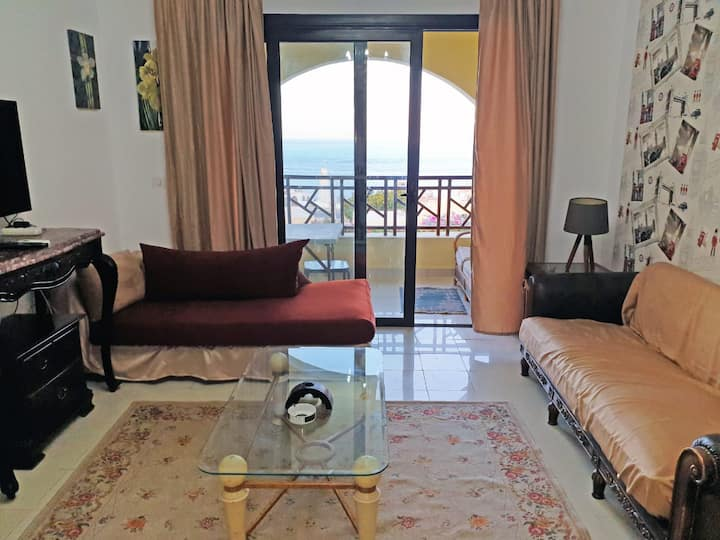 One bedroom in the compound with a private beach