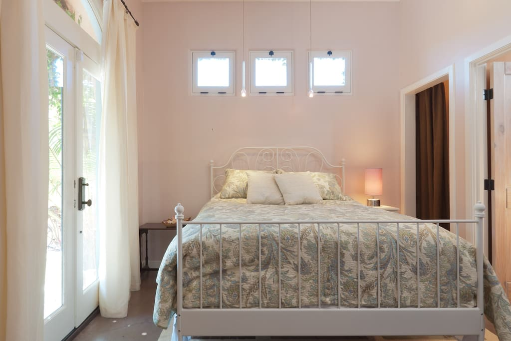 Queen bed with wrought iron frame.