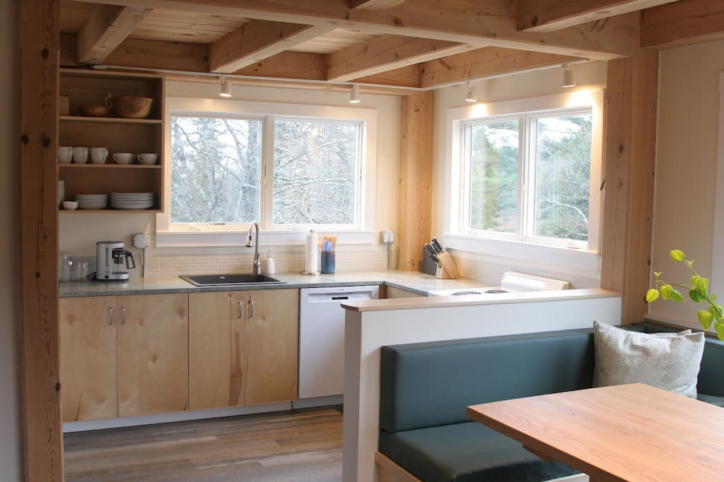 Fully equipped Kitchen with dishwasher, stove/oven, and granite counters.