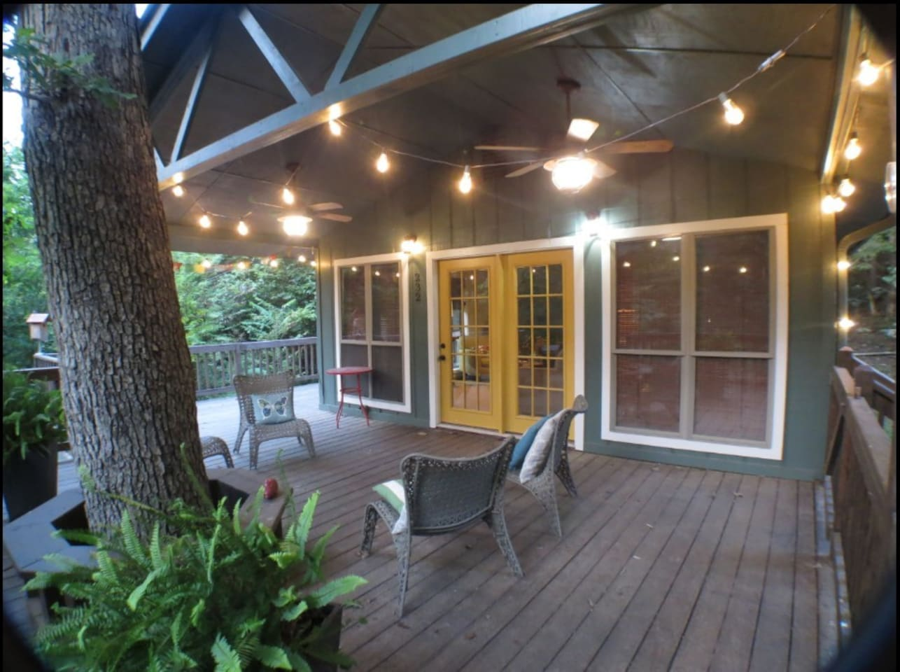 Oversized deck with charcoal grill and picnic table