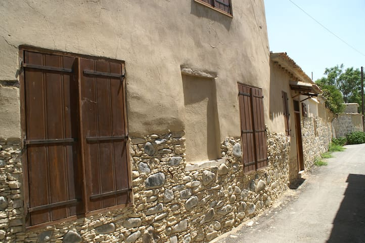 The outside walls of the house, made of traditional materials