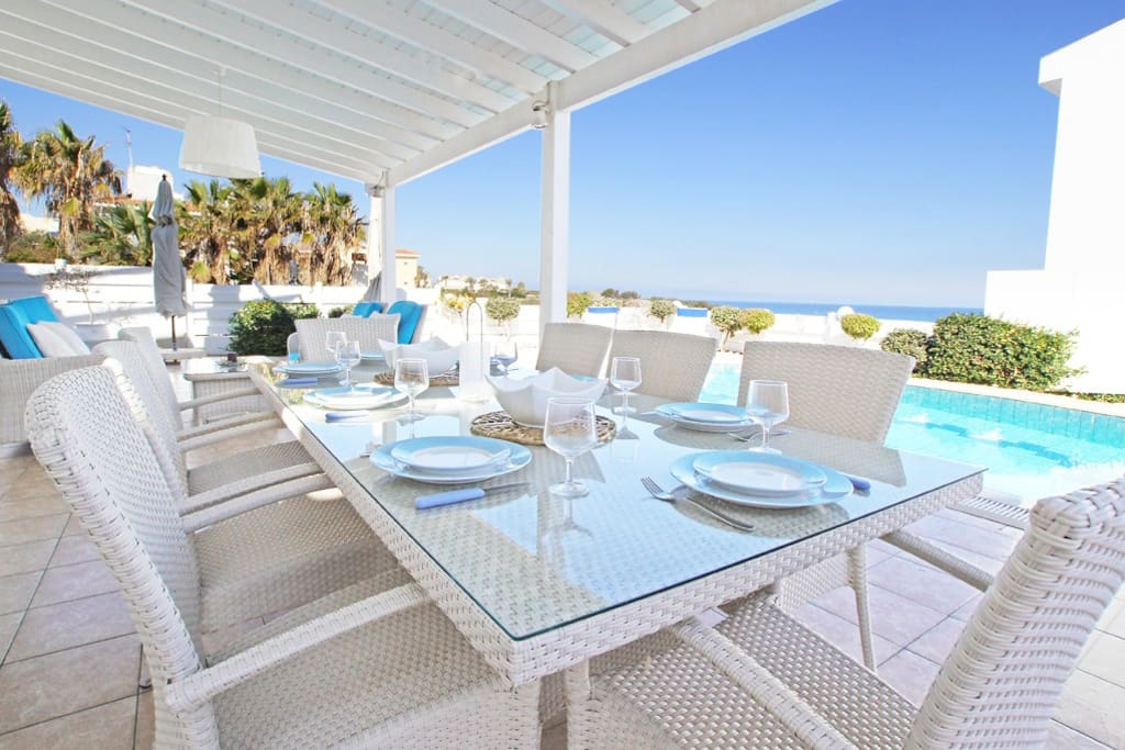 Outdoors dining area with sea views