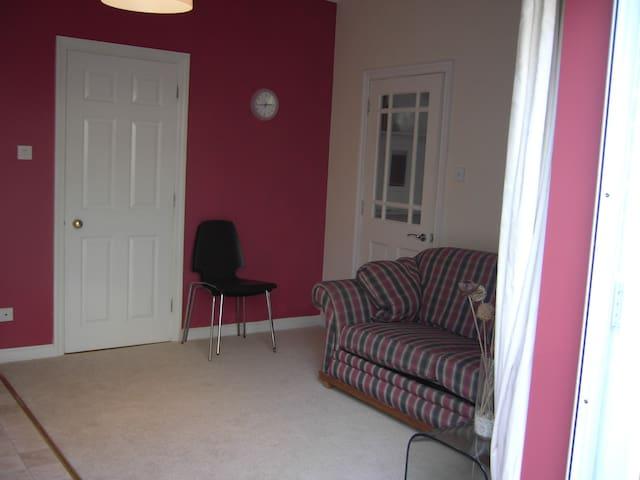 kitchen/living room via private entrance/patio doors