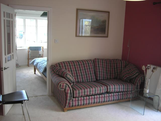 living area/sofabed with door leading to double bedroom