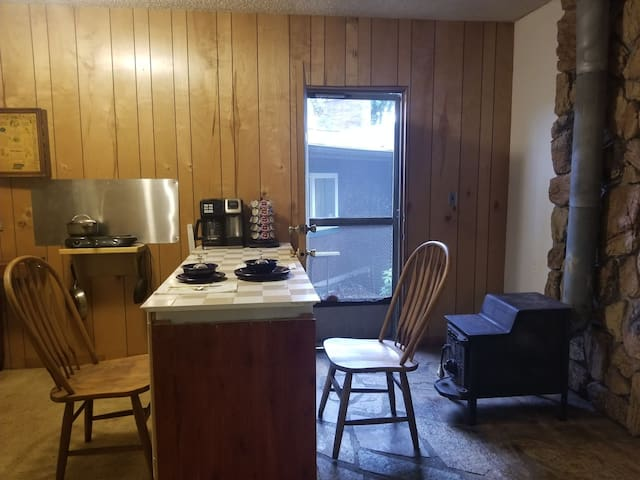 Kitchen/door to door yard/woodstove
