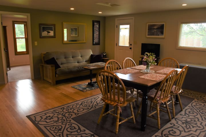 Open living concept with queen size fold out futon, spacious dining table, Roku with Spectrum TV, and WiFi. Plus new rear exit to private outdoor space.