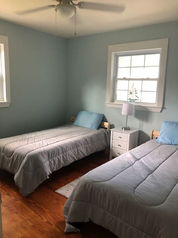 Brand new IKEA twin beds comfortably sleep two in this room. The lamp is also a USB charger to keep phones, Kindles and Switches fully charged. Big closet with hangers, extra pillows and linens.