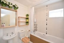 Spacious and clean toilet facilities with electric power showers..