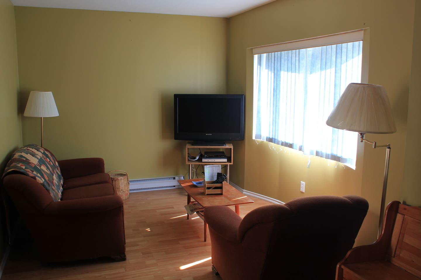 Living room - cozy, comfy.  27 inch TV, DVD player, basic cable included but you will probably be outside enjoying the fabulous Okanagan amenities