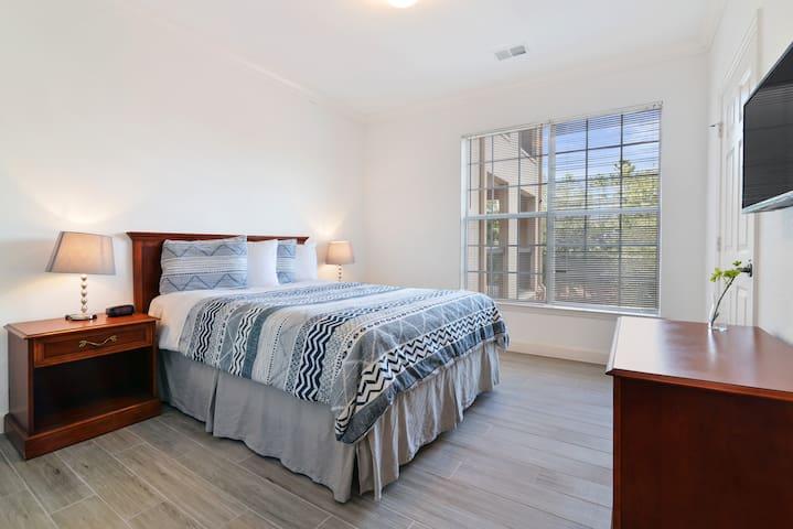 This condo Master suite features a queen bed, en-suite bathroom, and SMART TV