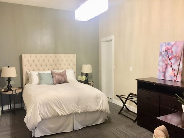 Comfortable bedroom with new  Beauty Rest mattress and down comforters duvets and pillows.