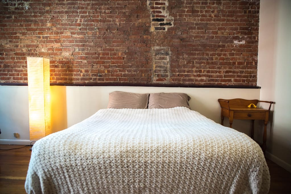 Queen bed with hand-woven bed spread