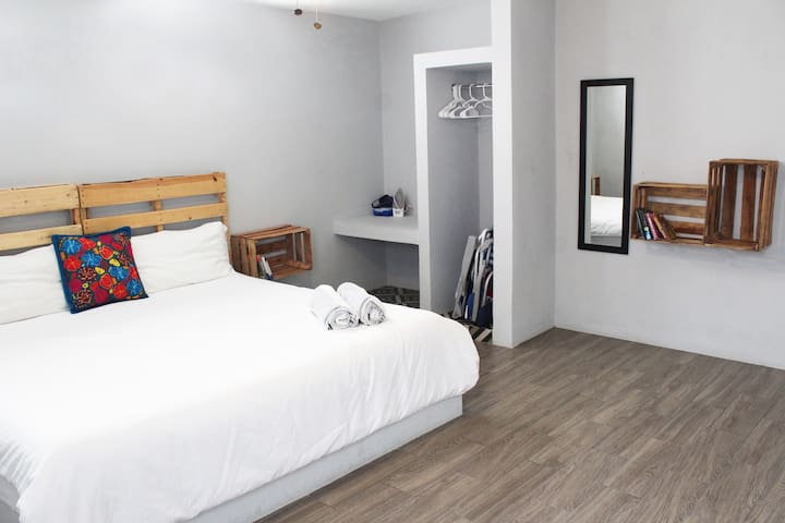 Spacious bedroom with fabulous king size bed, air conditioner, ceiling fan and closet