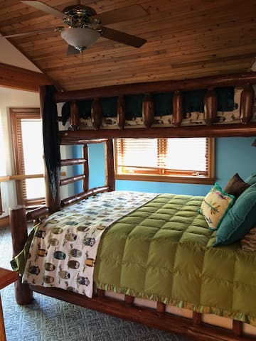 Upstairs bedroom with queen bed bunked with single. 2nd floor.