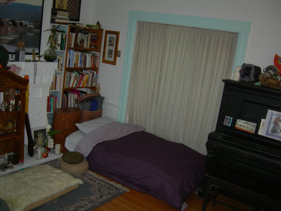 Here you can see the room with the bed set up.  We can offer the air mattress, shiatsu mat, or one on top of the other