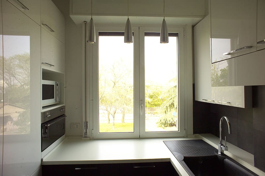 kitchen with oven, microwave and dishwasher