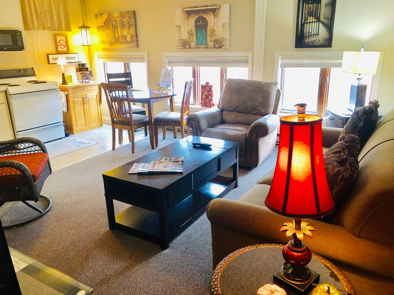 living room with sleeper sofa and dining area that overlooks historical Main street downtown Galena