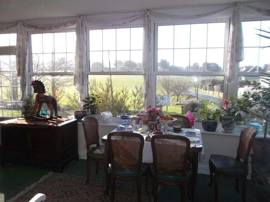 This is our sunny morning room where we serve breakfast looking out onto Seaford Head