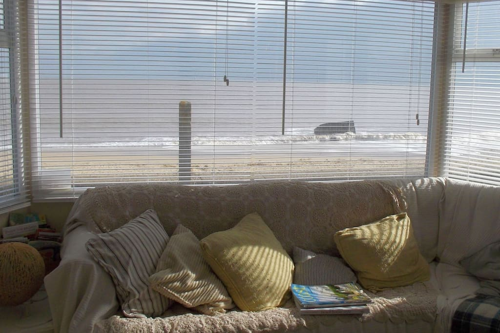 Stunning view of the beach from the comfort of your sofa....you may even spot a seal or a dolphin swimming in the sea!